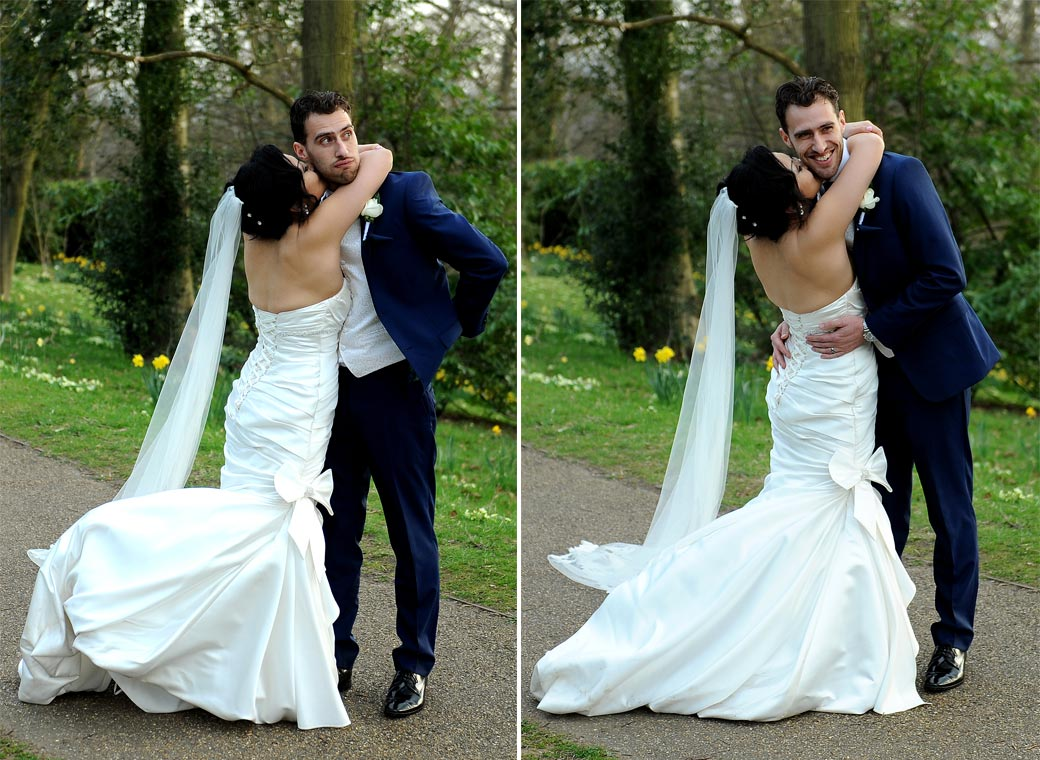 Fun Groom plays around in these light-hearted wedding pictures as his Bride gives him a loving hug on the path towards the lovely Pembroke Lodge in Richmond Park Surrey