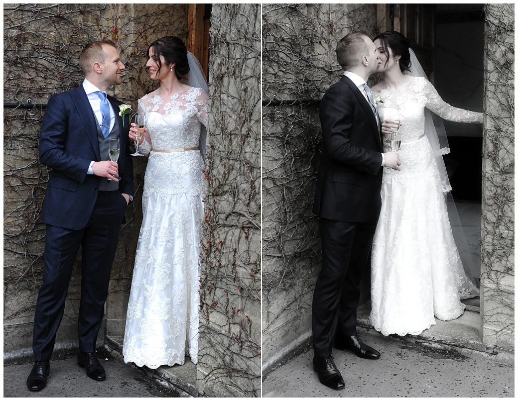 Newlyweds enjoy champagne and a romantic kiss captured at the exclusive and luxurious Surrey wedding venue Pennyhill Park located in the town of Bagshot
