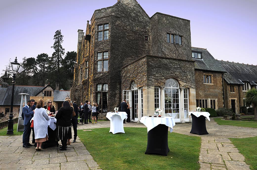 Various wedding guests enjoying themselves at Pennyhill Park during the drinks reception at this luxurious and welcoming Surrey wedding venue