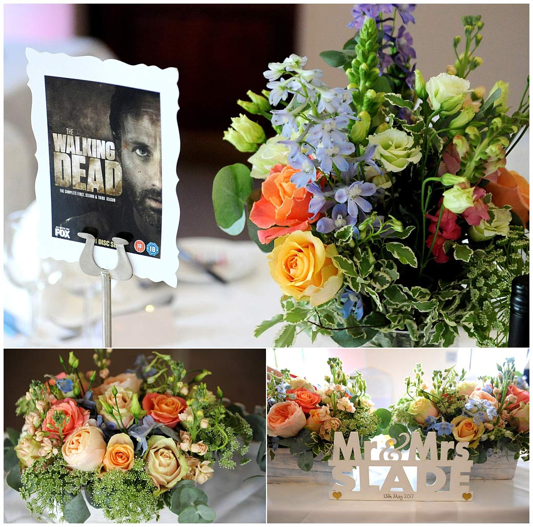Beautiful bright colouful table flowers and a Walking Dead table name captured at Surrey wedding venue Reigate Hill Golf Club in The Clarence Suite