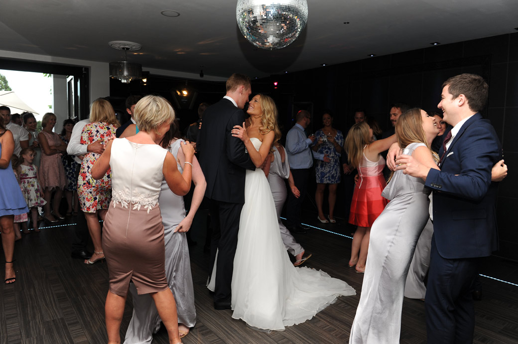 Wedding guests join the happy couple on the dancefloor captured by Surrey Lane wedding photographers at the wonderful Russets Country House in Chiddingfold, Godalming