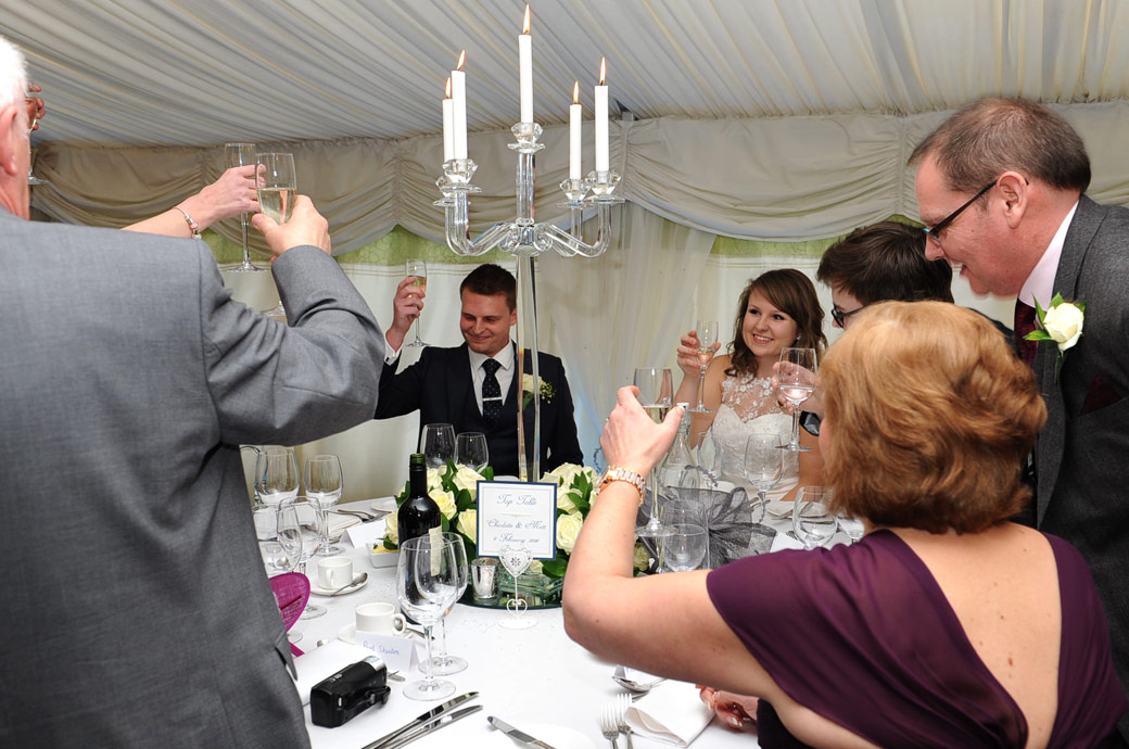 A final end of speeches wedding toast for the happy young couple  taken at the beautiful and very popular Surrey wedding venue Russets Country House