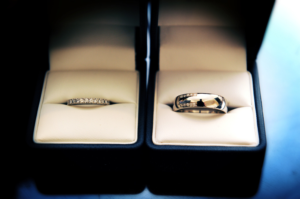 Beautiful sparkling and glistening wedding rings captured as they sit in their respective boxes and in the sole responsibility of the Best man in Surrey venue Selsdon Park Hotel Croydon