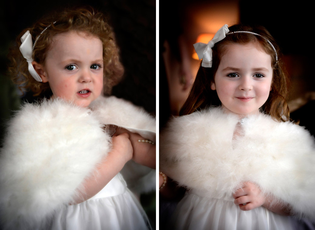 A delightful wedding picture of two sweet flowergirls dressed in white and wearing warm stoles captured at Selsdon Park Hotel Croydon Surrey