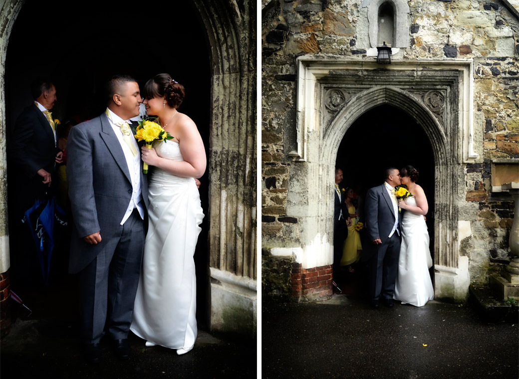 Romantic intimate moments in these wedding pictures taken outside the main door of Surrey wedding venue St Mary's Church in Oxted by Surrey Lane wedding photography