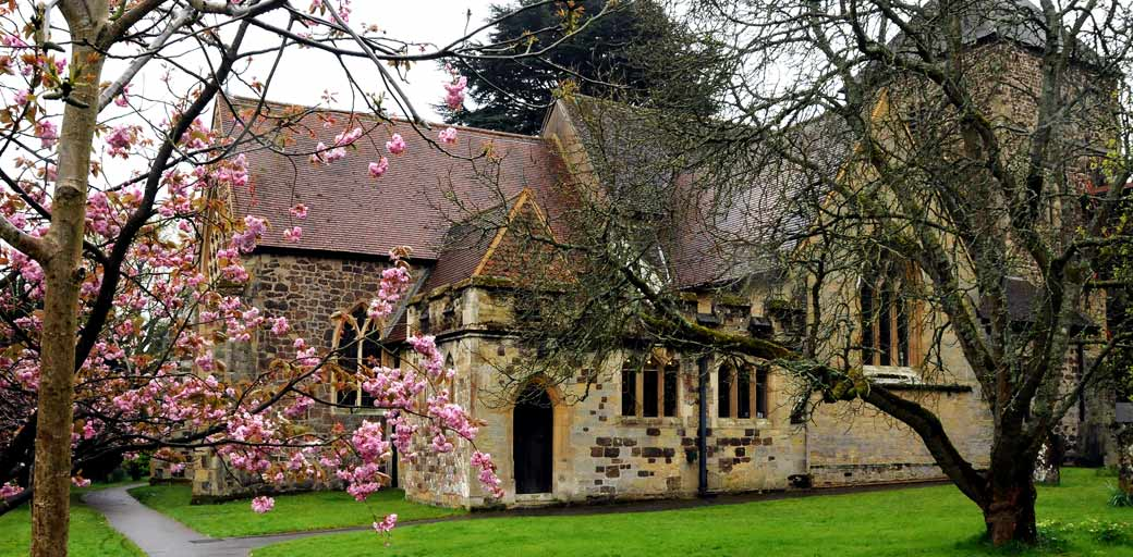 A picture of the historic and mediaeval St Nicolas Church Cranleigh a picturesque Surrey wedding venue set in lovely surroundings off the high street