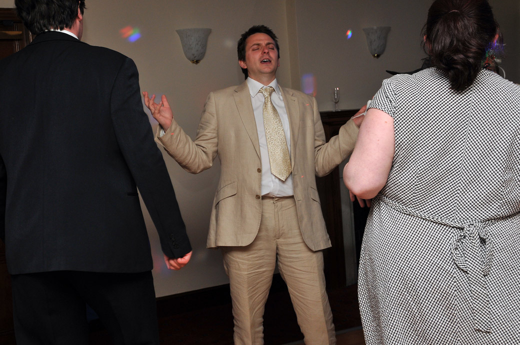 A guest in the zone as he sings on the dance floor in this wedding photograph taken on the Park View Suite dance floor of The Chateau in Croydon