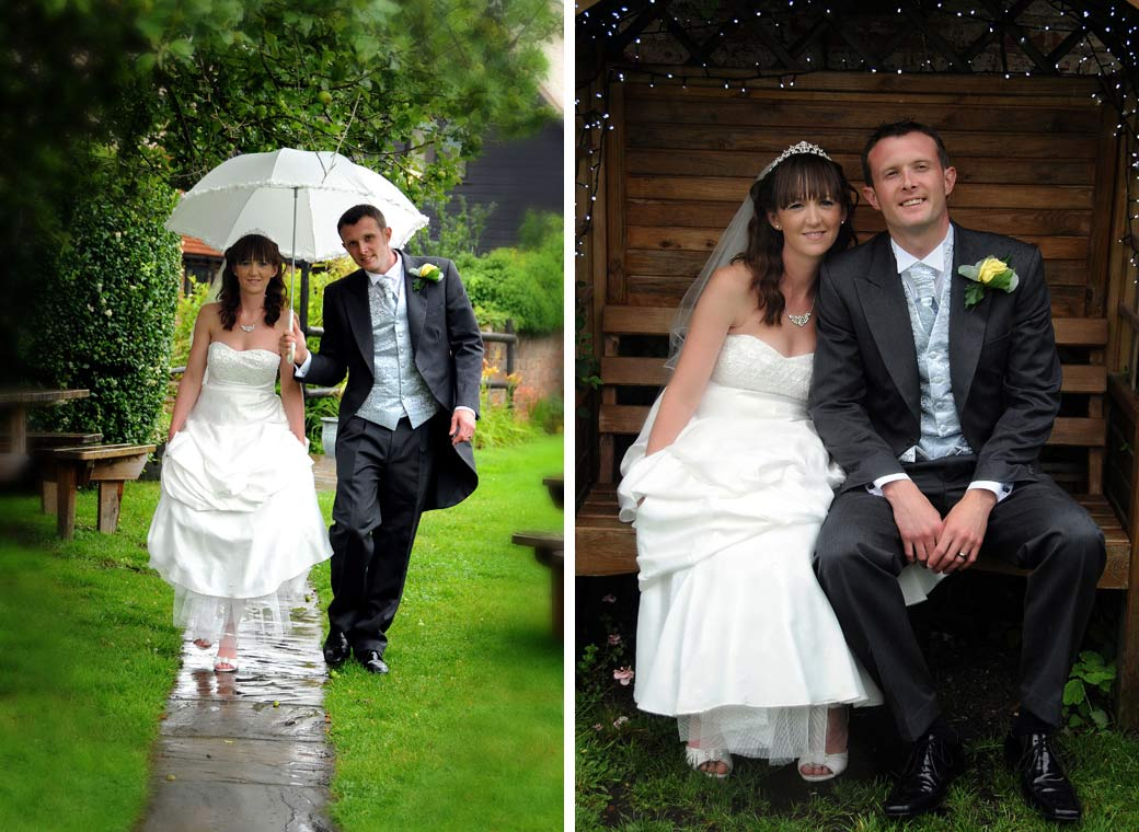 Walking in the rain and sitting on a bench wedding pictures taken in the garden at the historic coaching inn Surrey wedding venue, The Talbot, Ripley