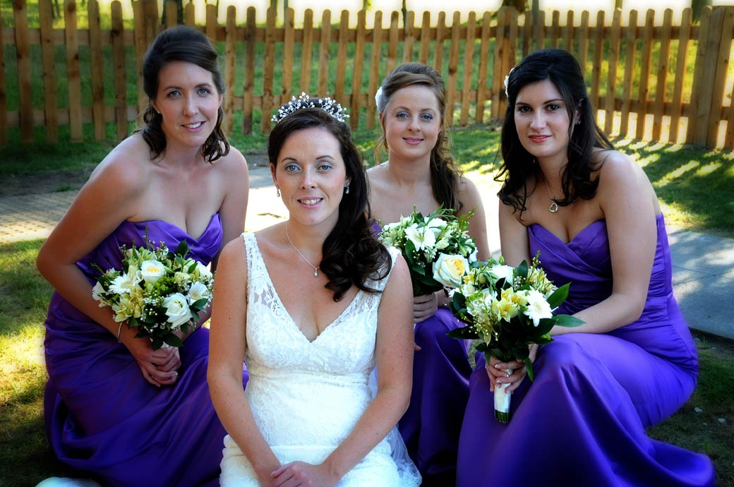 A lovely relaxed Bride and her Bridesmaids wedding photograph taken on the lawn at The Oaks Golf Centre in Carshalton Surrey