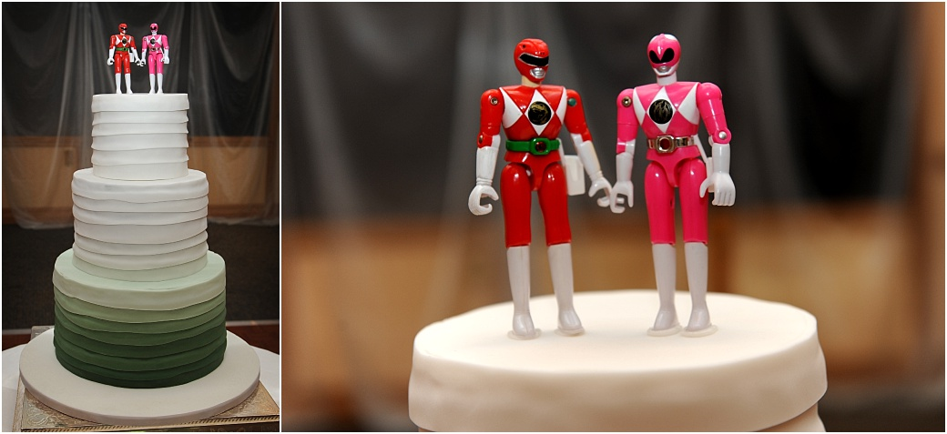 Striking looking wedding cake with unusual space age red be suited cake topper characters captured at Surrey wedding venue Warren House Kingston in The London Room