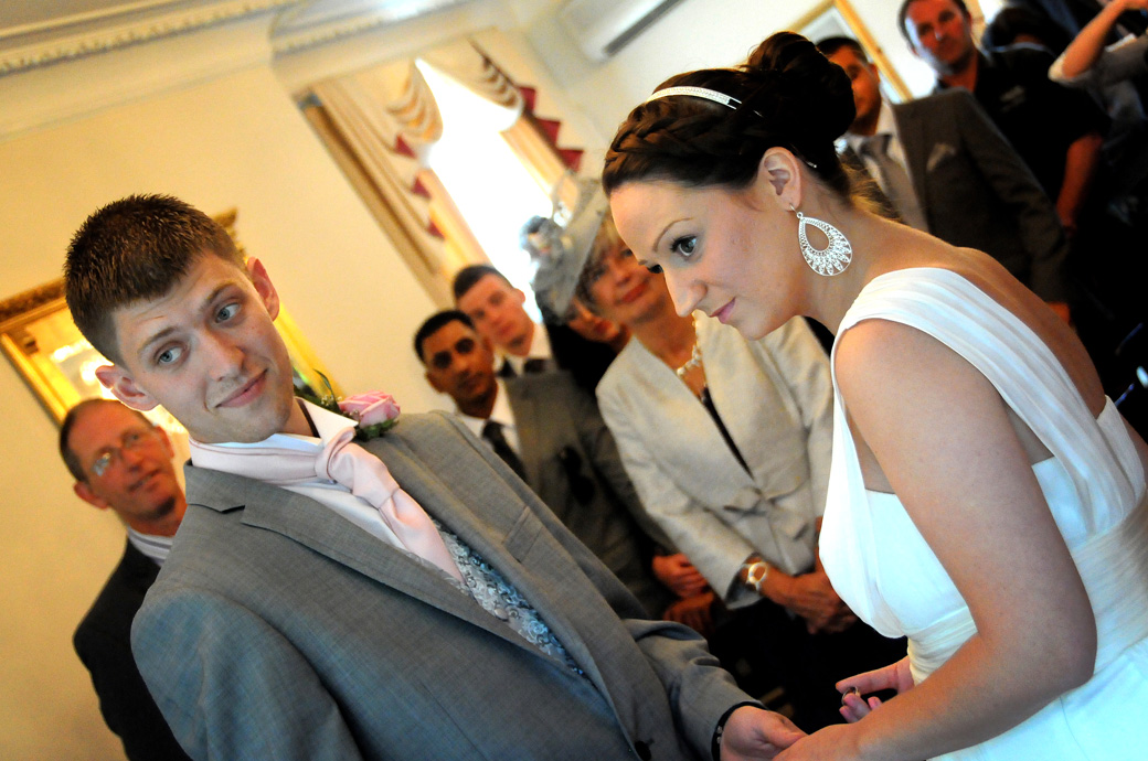 Bride and Groom concentrating intensely as they look to the registrar in this Surrey wedding service photo at Weybridge Register Office