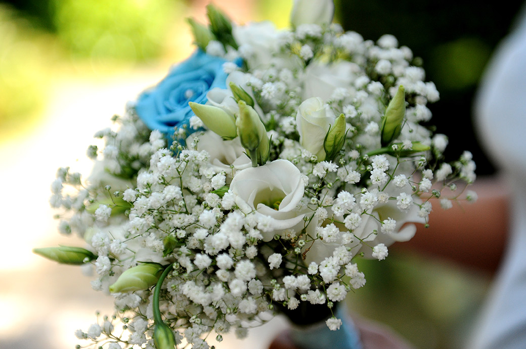 Colourful blue and white wedding flower bouquet captured at the ever popular Surrey marriage venue Weybridge Register Office