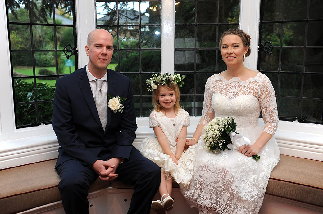 Sweet intimate family wedding photo captured at the popular Surrey venue Weybridge Register Office in the window alcove area in the Rylston Suite