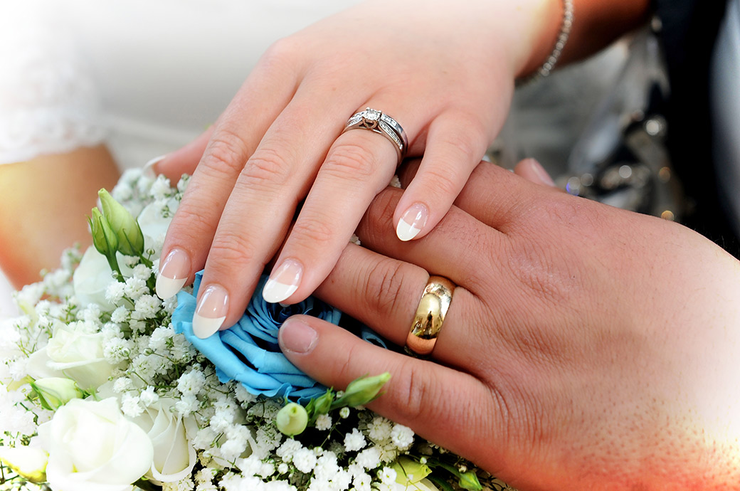 Shiny wedding rings on show after a marriage ceremony at Weybridge Register Office an ever popular suburban Surrey wedding venue