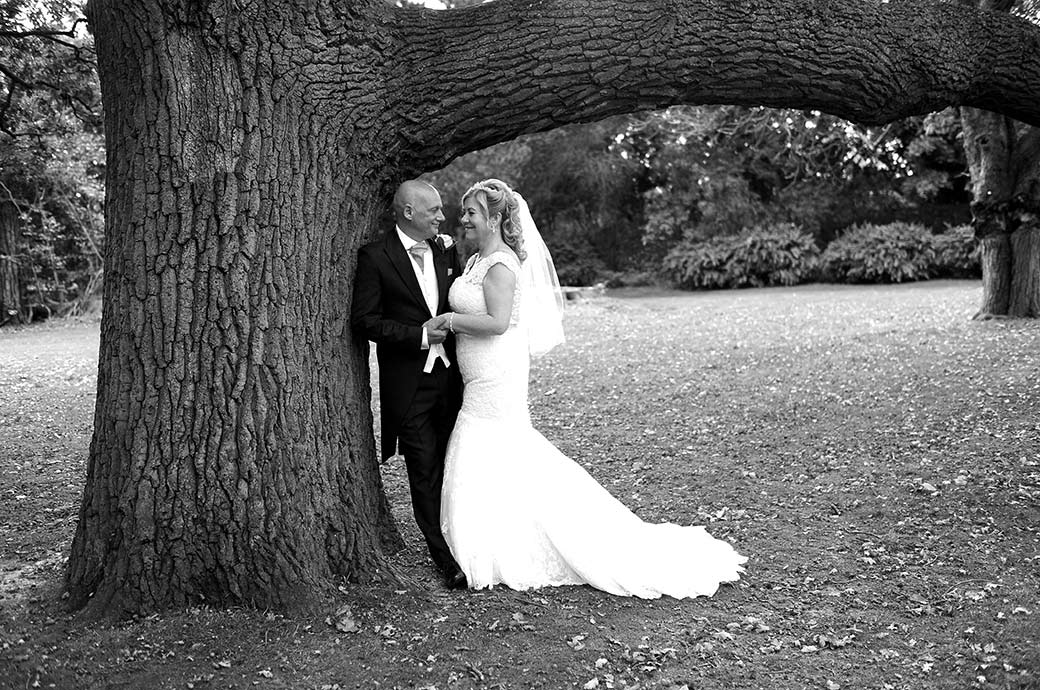 A special romantic moment for the newlywed couple as they talk to each other below a large oak tree in the grounds of Woodlands Park Hotel in Stoke D'Abernon Surrey