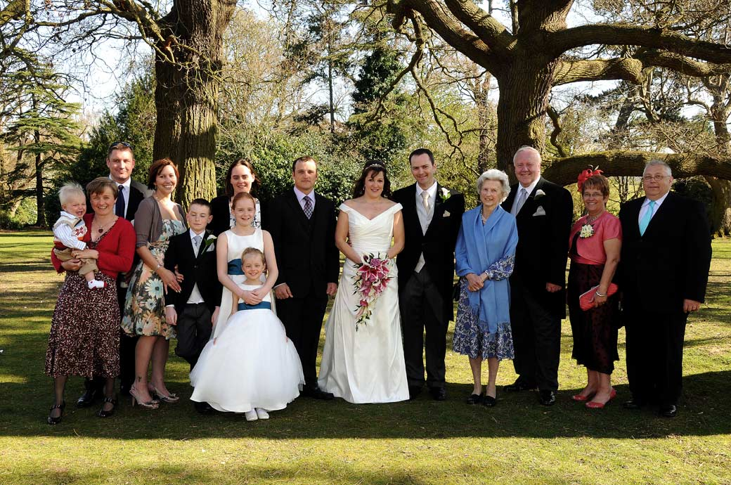 A relaxed and jolly family group wedding photograph taken in the pleasant surroundings of Woodlands Park Hotel by Surrey Lane wedding photography