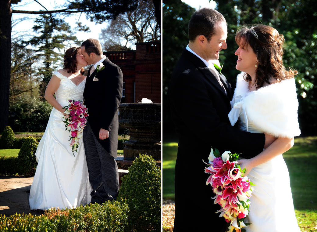 The happy couple holding each other and kissing in these informal and romantic wedding pictures Woodlands Park Hotel by Surrey wedding photographers