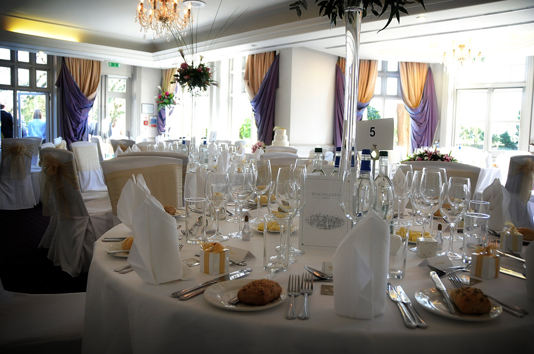Tables all set ready for the guests in this wedding photo taken in The Cornwall Suite at Surrey wedding venue the Woodlands Park Hotel a fine Victorian mansion