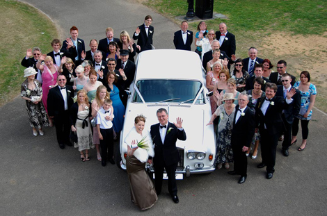 Everyone waving in front of the Rolls Royce wedding picture taken from the Ewart Room at Merton Register Office Morden Park House, Surrey