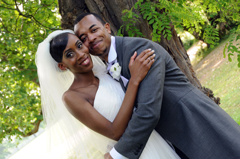 Beautiful happy man and wife wedding picture taken in Morden Park at Merton Register Office in Morden Park House a lovely Surrey wedding venue