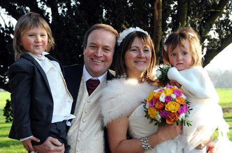 Happy smiling family wedding photo captured in Morden Park after a Merton Register Office Morden Park House wedding