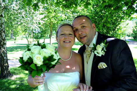 Happy wedding couple wedding portrait taken under the shade of the trees at Surrey wedding venue Shirley Park Golf Club Croydon