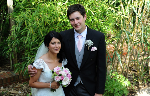 A relaxed Bride and Groom wedding photograph taken after their marriage at Surrey wedding venue Christ Church Sutton