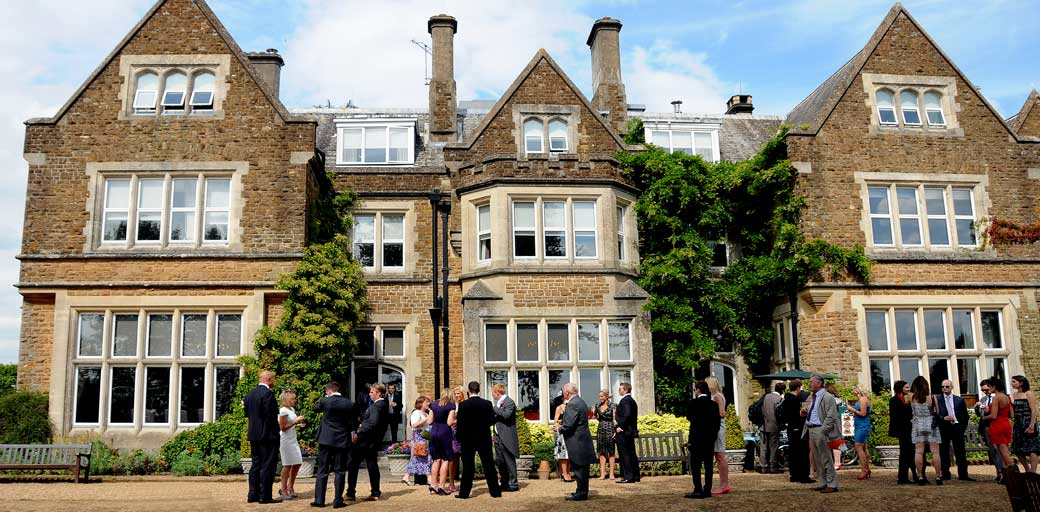 Photograph of the impressive facade of Hartsfield Manor a grand Victorian mansion house situated in Betchworth and a fine Surrey wedding venue