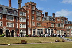 The vast rambling red brick Jacobean Croydon wedding venue and Golf club that is Selsdon Park Hotel as captured by Surrey Lane wedding photography