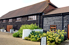 A wedding picture of the charming and rustic Gate Street Barn a truly tranquil and beautiful Surrey wedding venue hidden away in the Surrey Hills and five miles from Guildford