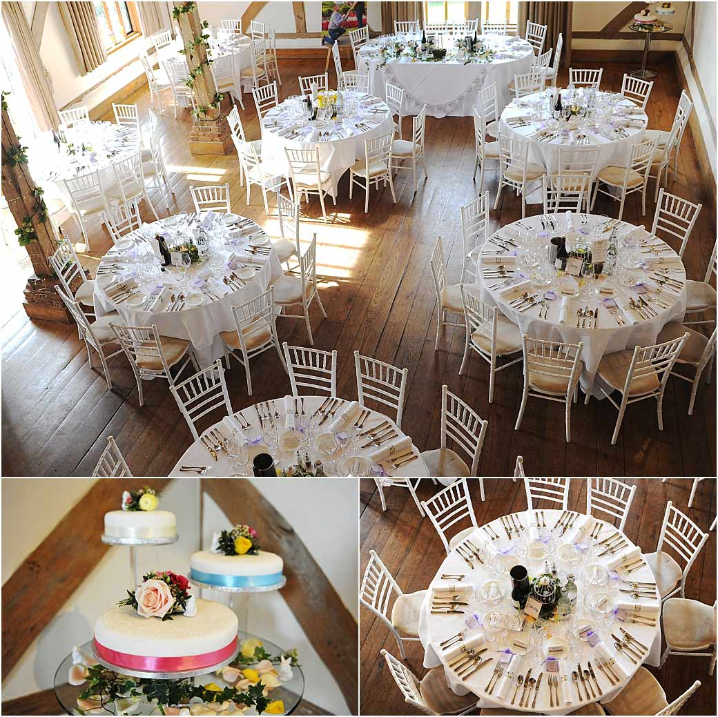 The wedding cake and tables set out for the wedding breakfast at Surrey venue Cain Manor captured from the minstrel gallery