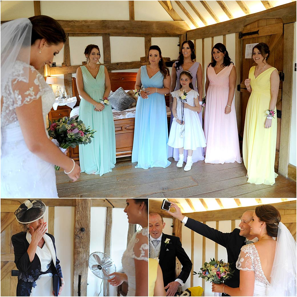 Emotional moment for the bridesmaids and parents at Surrey wedding venue Cain Manor as they see the Bride for the first time in her beautiful wedding dress