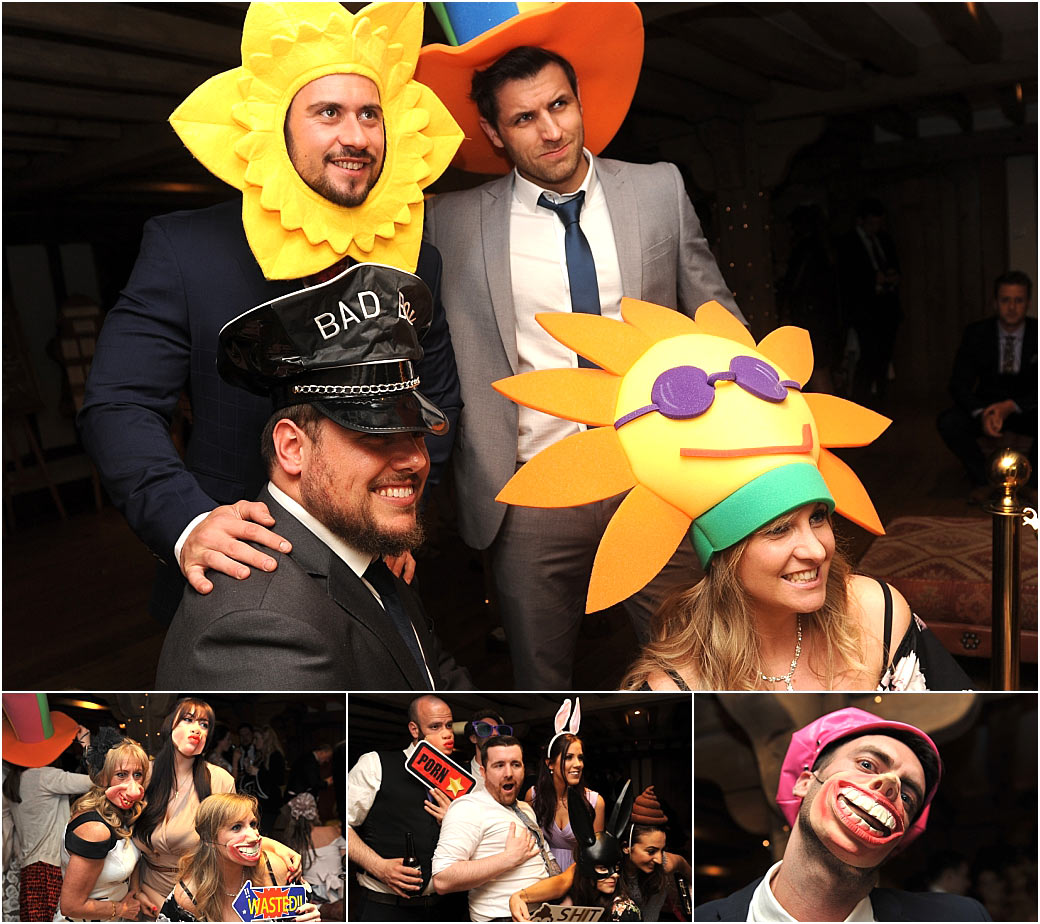 Colourful fun captured at the lovely Surrey wedding venue Cain Manor in Headley Down as the guests try on the costumes from the photo booth