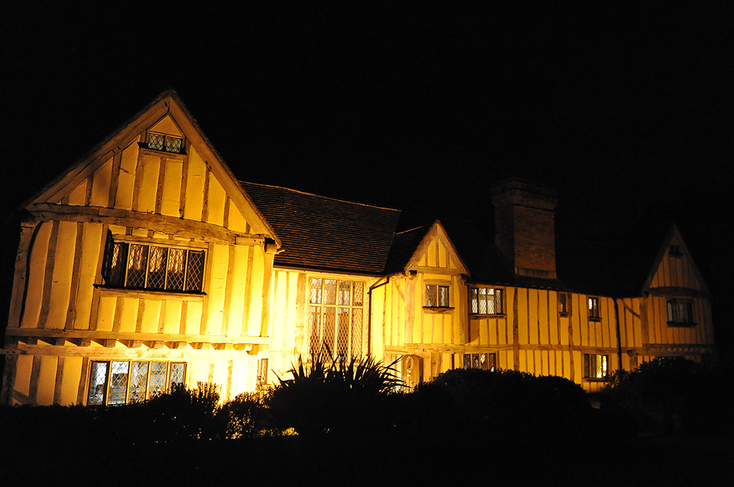 Atmospheric night time picture of the delightful and charming wedding venue Cain Manor situated in Headley Down Surrey