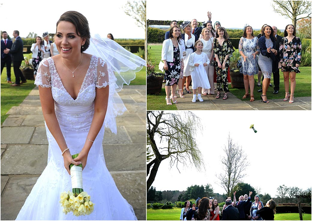 Lovely bride and her ladies have fun during the throwing of the wedding bouquet in the grounds of the picturesque Cain Manor in Headley Down Surrey