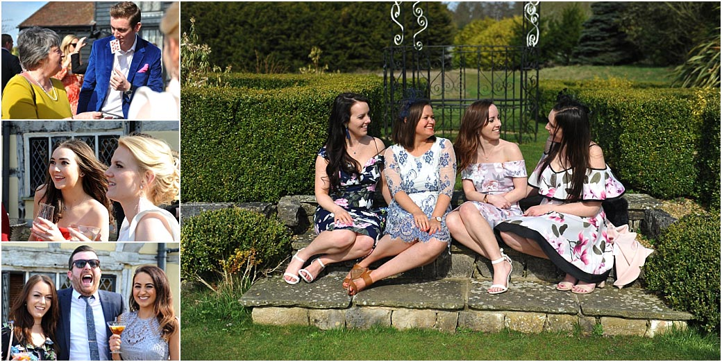 Guests at the picturesque Surrey wedding venue Cain Manor relaxing in the sun, having drinks and being entertained by a slight of hand magician