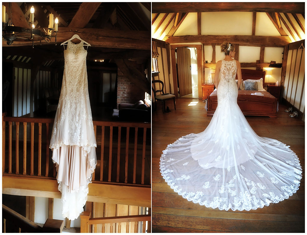 Beautiful wedding dress on show handing from the oak beams and on the Bride taken at the wonderful Cain Manor a bijou Surrey wedding venue in Headley Down