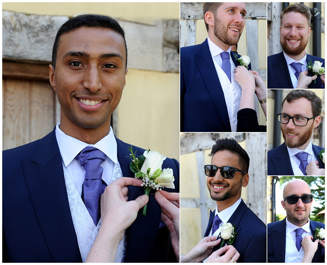 All smiling Groom and groomsmen captured on the morning of the wedding at bijou Surrey venue Cain Manor as they have a hand with their button holes