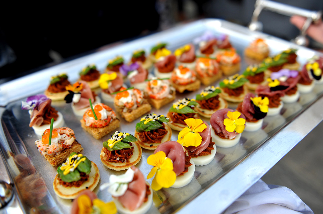 Beautiful bright and colourful Great Fosters canapés on show during the drinks reception on the terrace at this very special and fascinating Surrey wedding venue in Egham