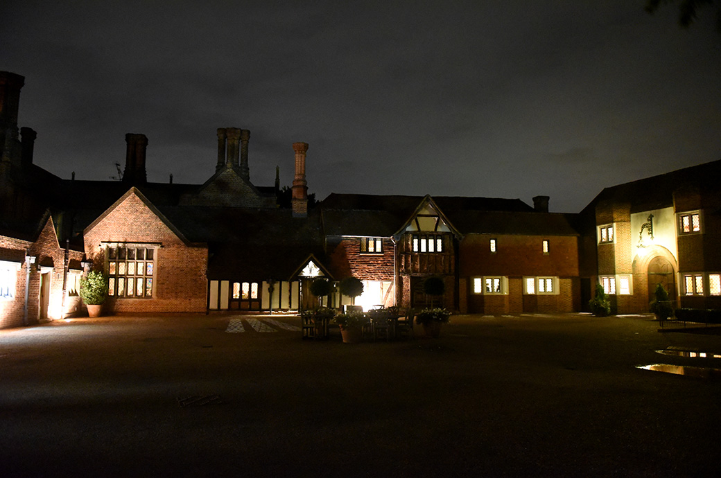 Atmospheric night time picture taken from the courtyard of the entrance to the ancient Tithe Barn at the wonderful wedding venue Great Fosters Egham Surrey