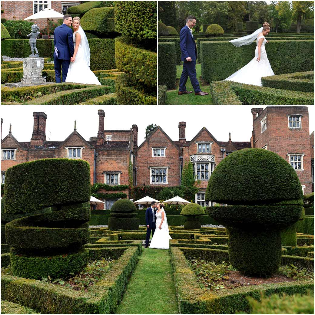 Bride and groom captured in these pictures taken in the formal Parterre garden at Surrey wedding venue Great Fosters as the walk through the narrow paths and kiss