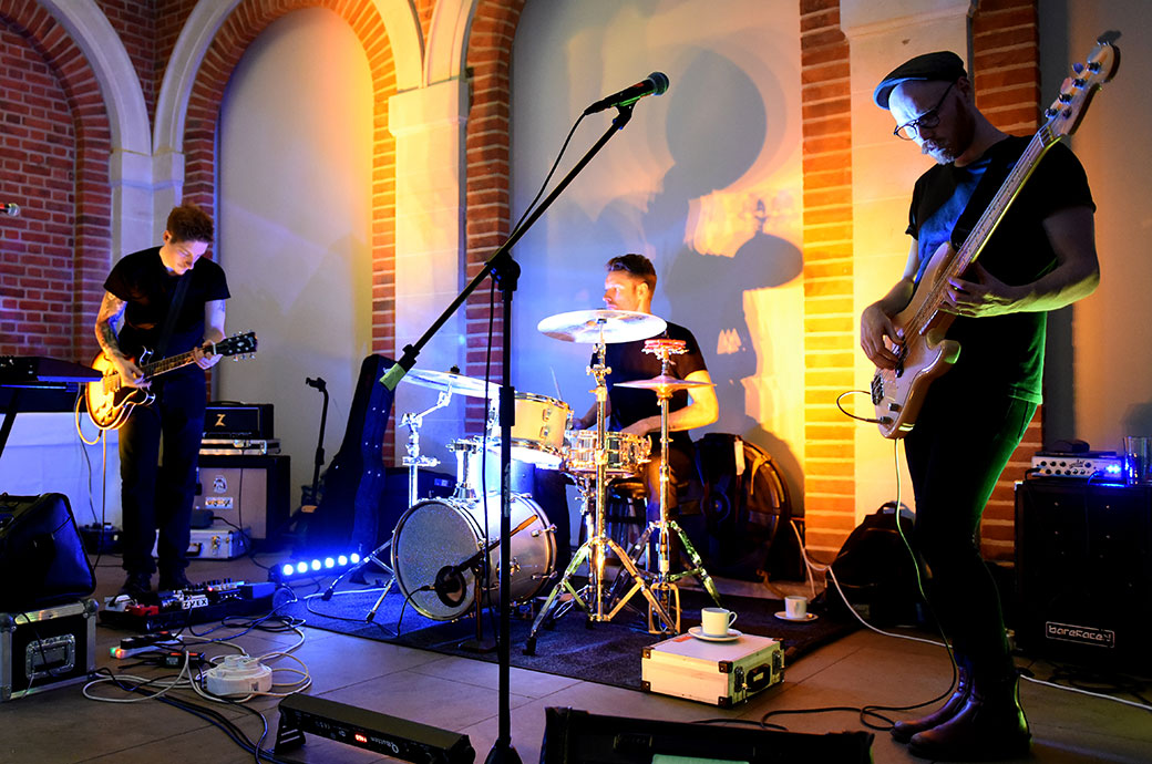 Atmospheric picture of the wedding band Teenage Kicks at Surrey hotel and event venue Great Fosters tuning up ready for the first dance in The Orangery