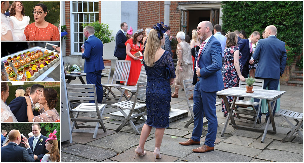 Wedding guests out on the terrace at the magical Surrey venue Great Fosters enjoying themselves over fine drinks conversation and canapés