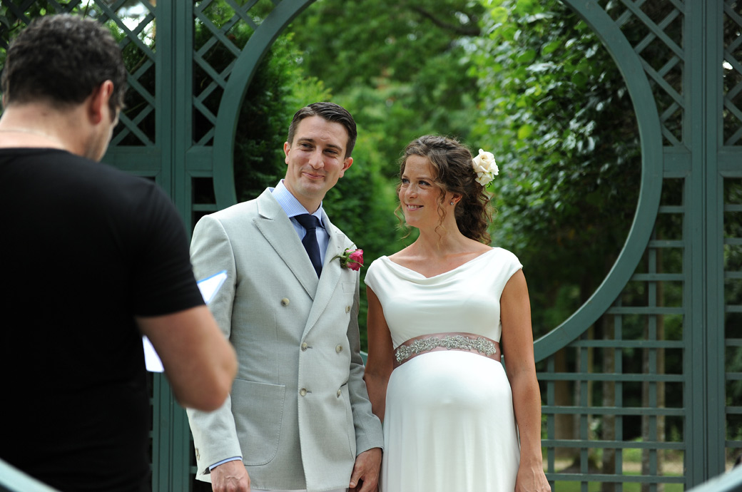 Delightfully happy and smiling newly-weds after they are pronounced husband and wife in this lovely Hindhead Surrey wedding photograph