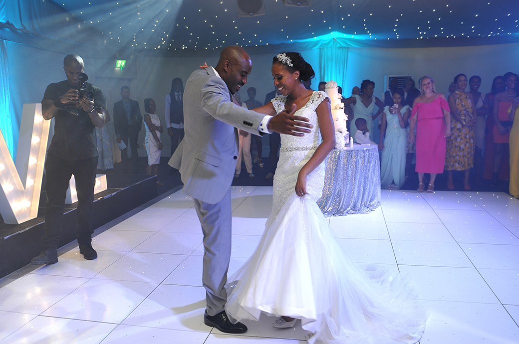 Bride and Groom enjoying their enthralling first dance moves captured at Surrey wedding venue Painshill Park on The Conservatory dance floor