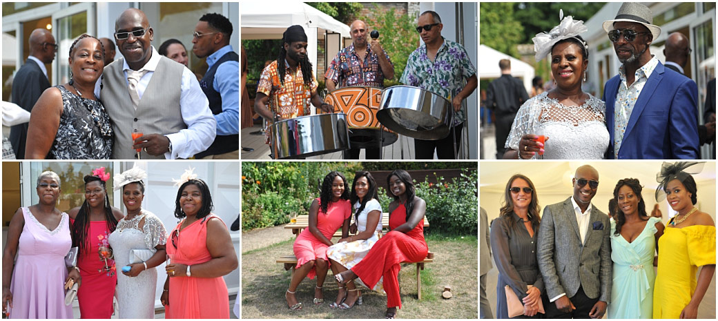 A steel band, guests in colourful summer clothes with red drinks chatting and relaxing at Painshill Park in Cobham Surrey in the beautiful and unique Walled Garden venue