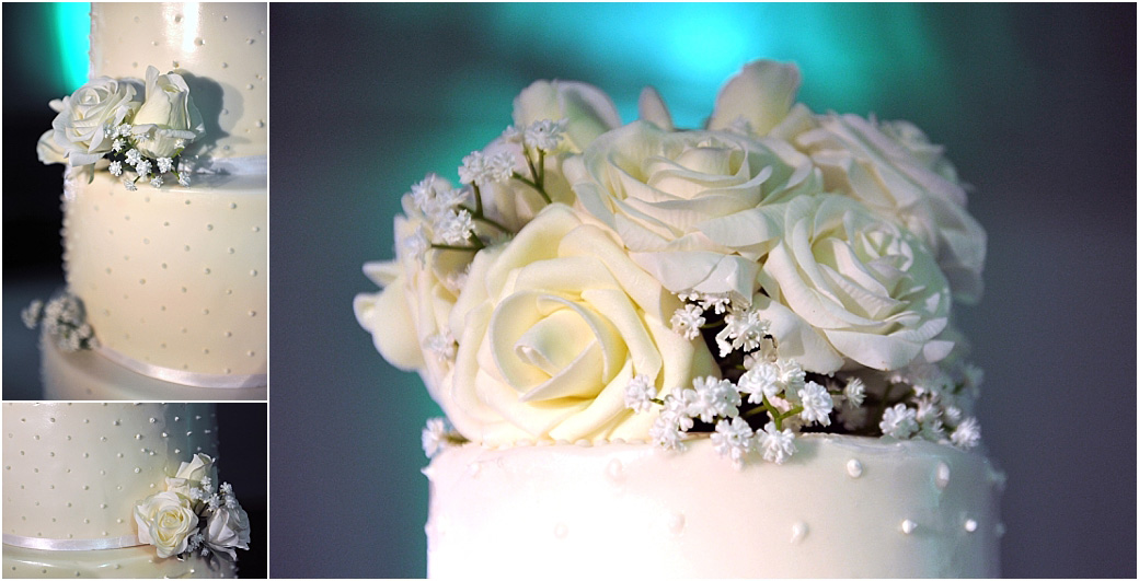 Close up details of a white studded wedding cake with yellow roses captured at the popular an scenic Surrey wedding venue Painshill Park in The Conservatory