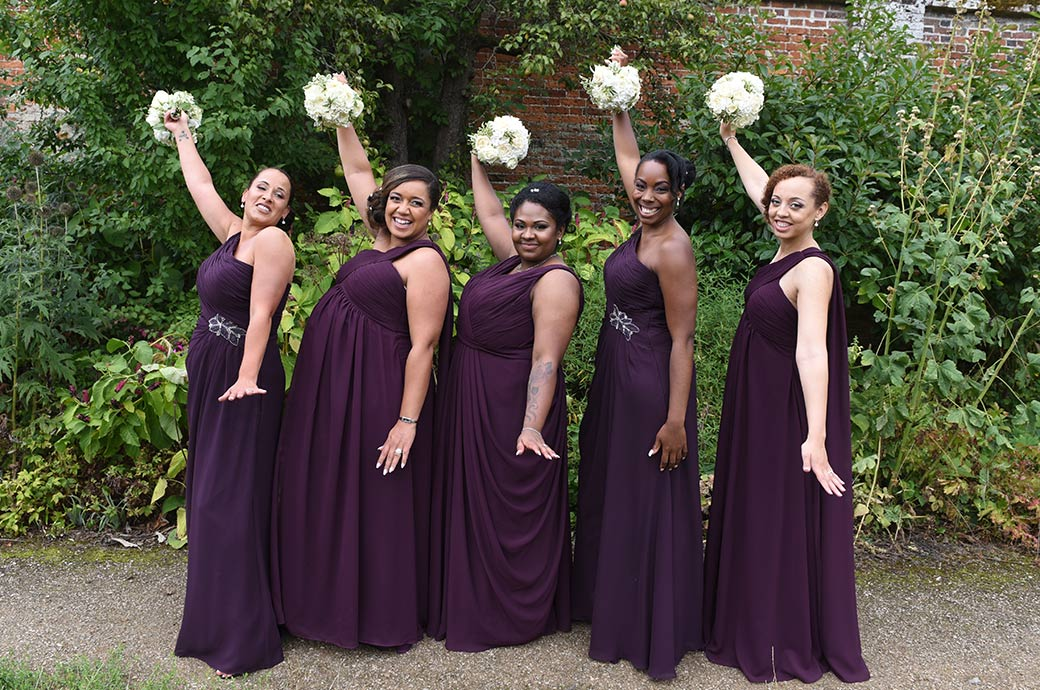 Lovely happy smiling Bridesmaids strike a pose in The Walled Garden at the magical Surrey wedding venue Painshill Park in Cobham