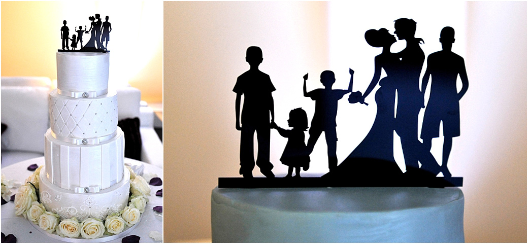 Interesting Silhouette cake topper of a Bride and Groom with four children taken in The Conservatory at the Painshill Park wedding venue in Surrey