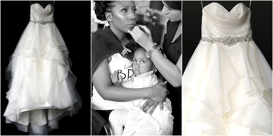 Lovely pictures of a Bride's wedding dress hanging as she has her make up applied whilst holding her daughter near Painshill Park in Cobham Surrey